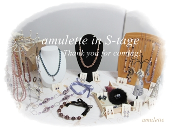 amulette in s-tage