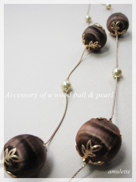 wood ball and pearl accessory