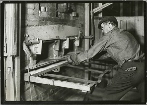 man-operating-a-brick-oven.jpg