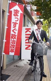 自転車で1日平均50キロの街宣活動をしているという横粂氏