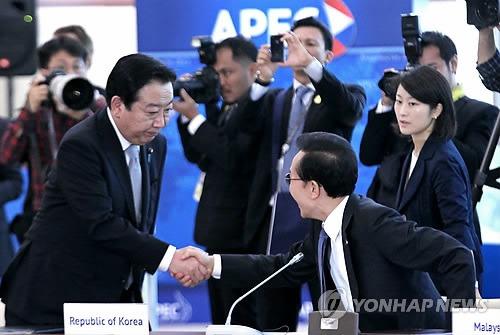 未来志向の協力で一致=日韓首脳