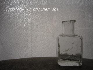 バリカン油の瓶 窓辺で