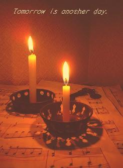 ブリキの玩具に蝋燭を灯して