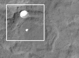 The Registar - Curiosity snapped mid-flight by Mars Reconnaissance Orbiter