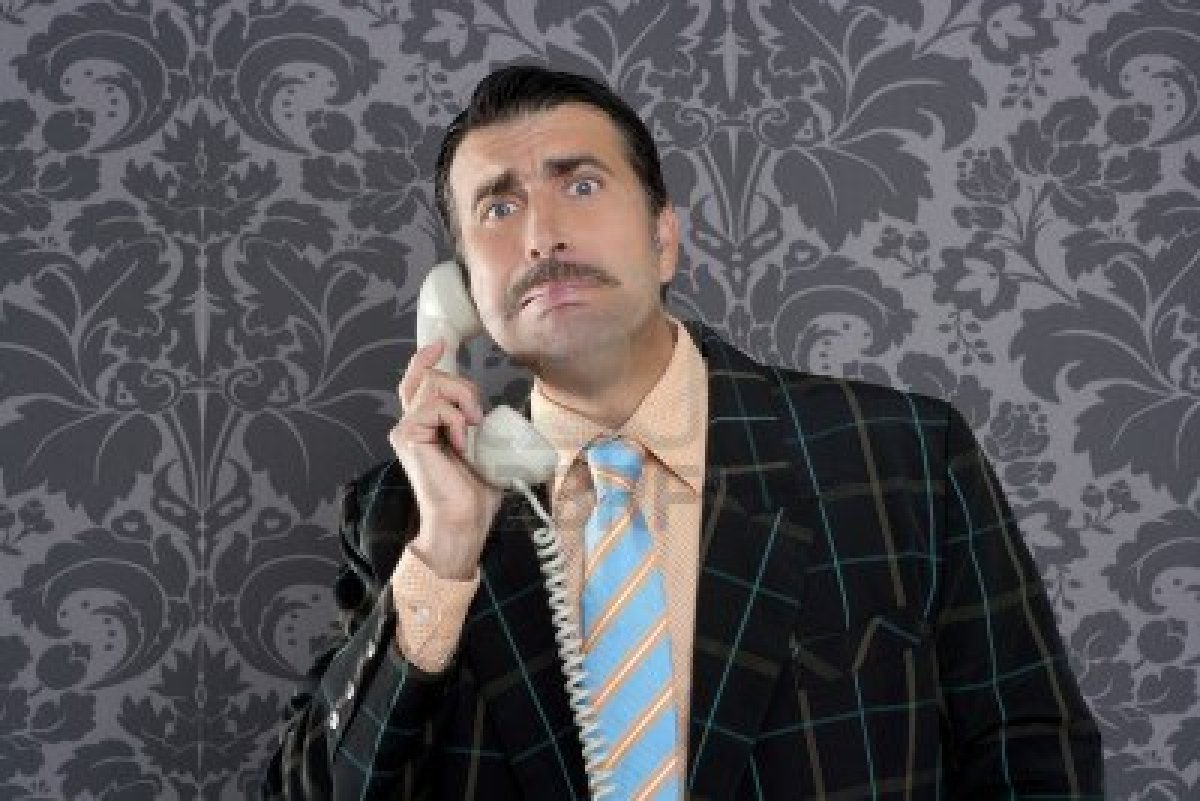 9941997-businessman-with-scared-expression-talking-by-telephone-with-retro-mustache.jpg