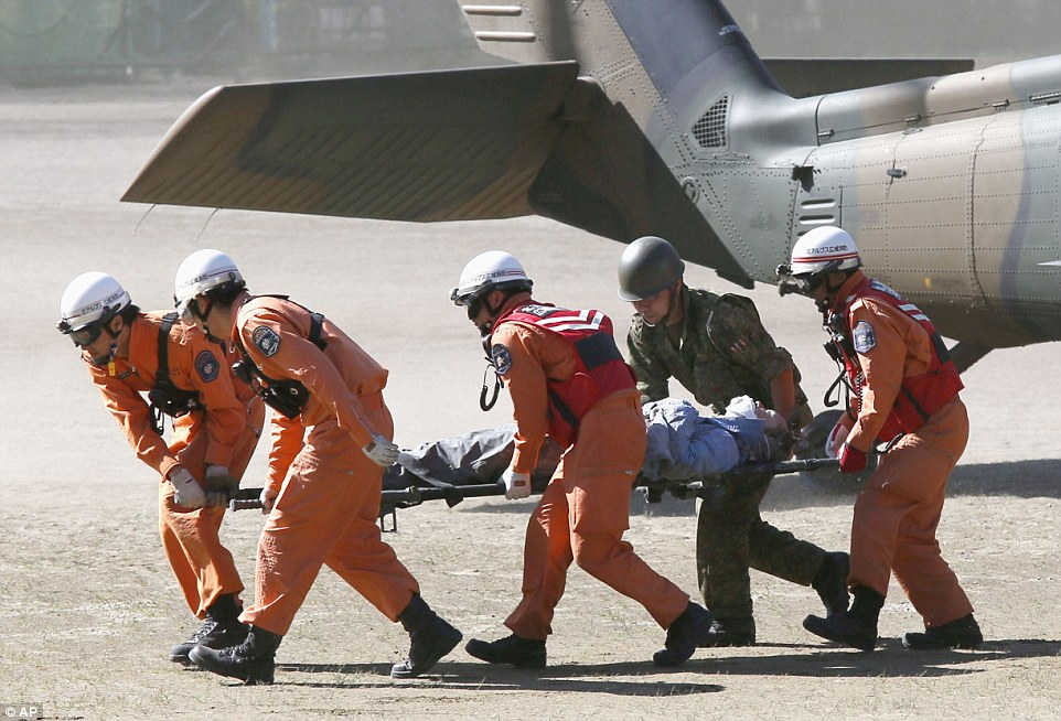 1411894653800_wps_28_Rescue_workers_carry_a_cl.jpg