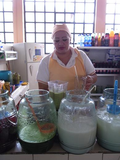 a lady at a fresh juice bar