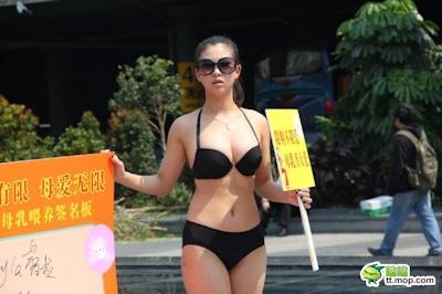 高清:深圳妙龄女子穿比基尼倡议母乳 1
